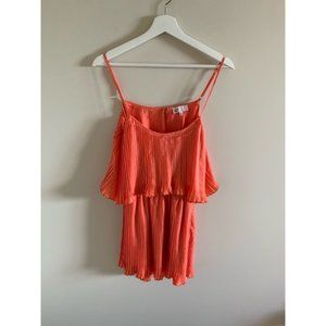 Revolve by the way. Pleated Coral Mini Dress